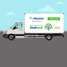 Greater Lansing Food Bank mobile pantry sets up at Delta Dental with support from McLaren Health Plan